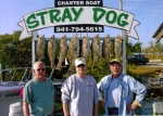 Ron Winn, Stu Hanke, and Ken Stair showing of their 'catch' from deep sea fishing in Florida.